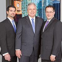 Group portrait of attorneys at Trapp & Geller